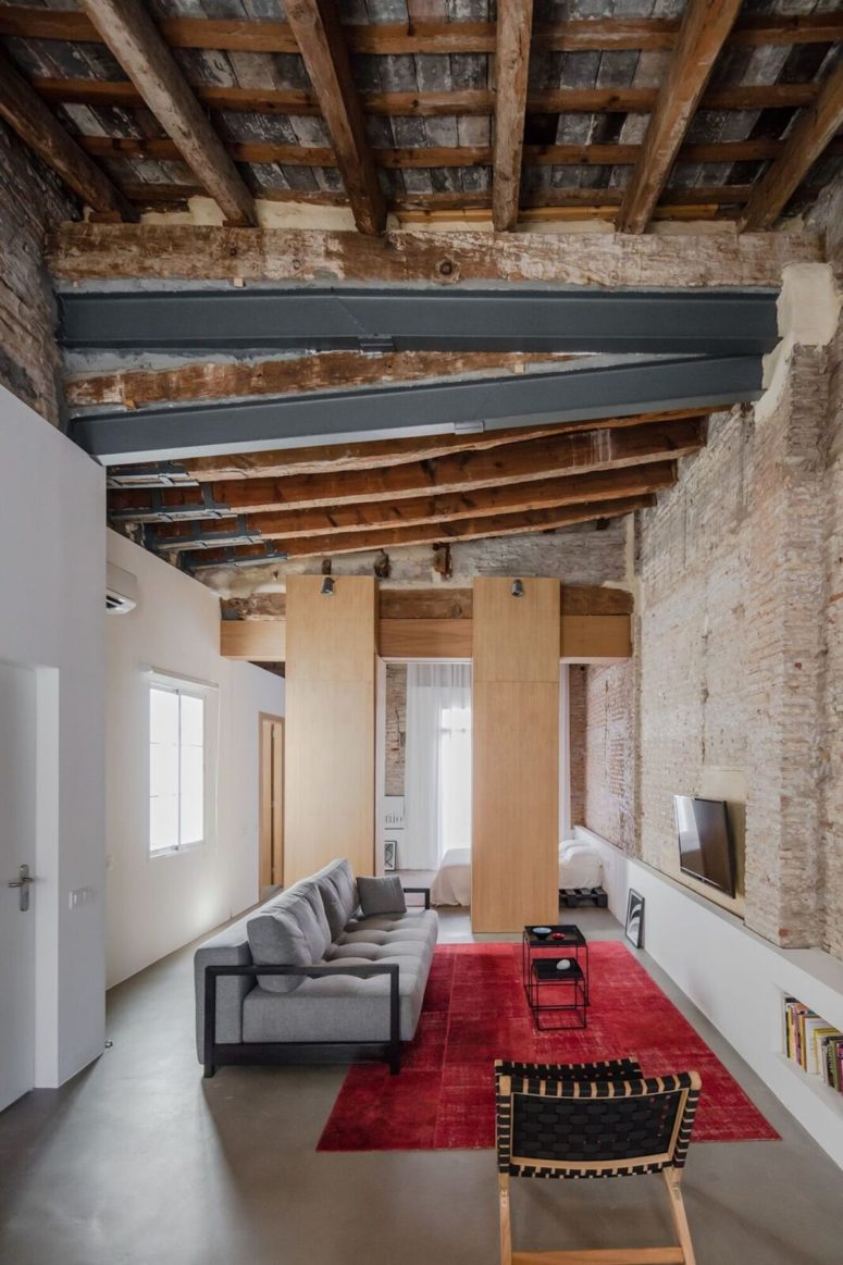 This modern apartment was renovated with focusing on the old features and preserving them for giving it a character