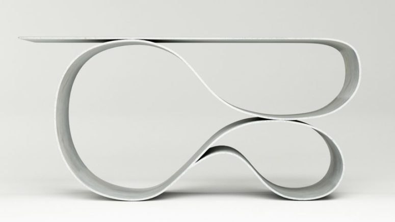 Whorl console table is made of fabric concrete and it features a unique shape