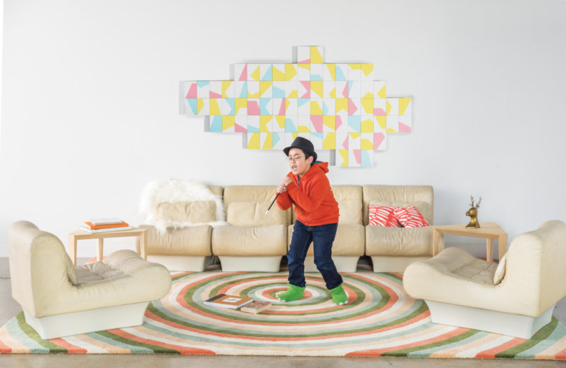 Infinity Daylight rug with bold green and orange circles