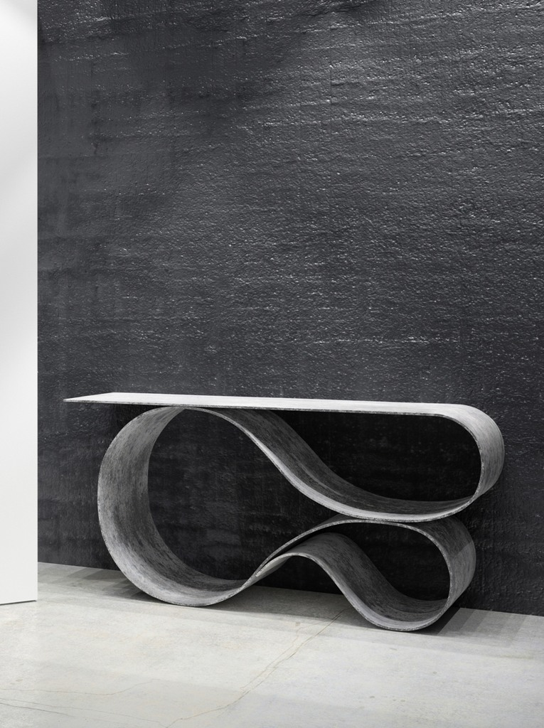 The console has an amazing fluid shape that is usually not associated with heavy concrete
