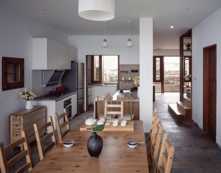 The dining space and kitchen are in an open layout, all the rooms are centered around the sea views