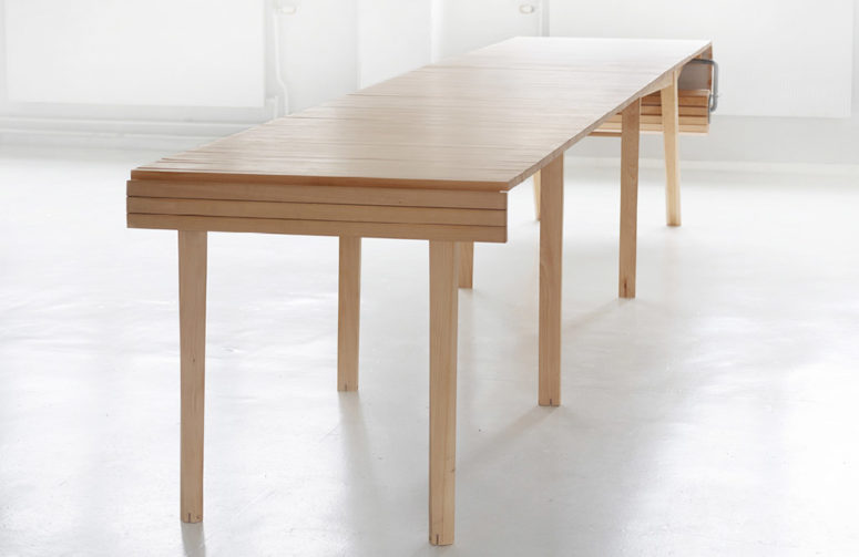 The table features some wooden slats and a crank to make it larger or smaller when needed