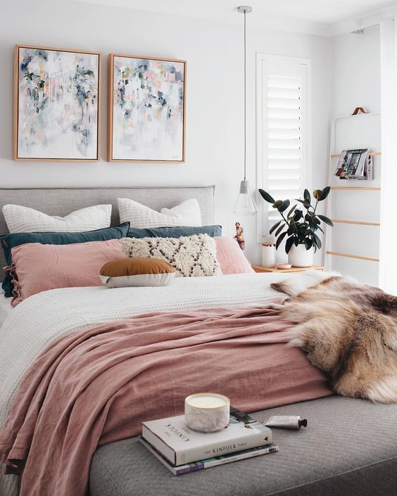 a couple of abstract watercolor artworks over the bed  will brign a fresh spring touch