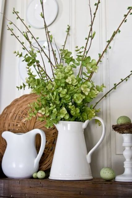 a jug with greenery and green hydrangeas, green speckled eggs and some white porcelain