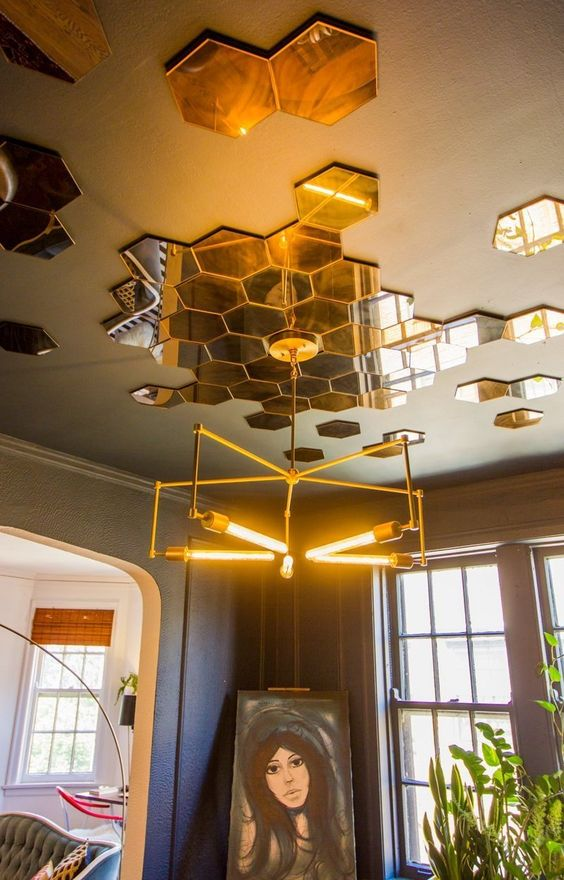 add hexagon tiles to the ceiling to make the space more contemporary and bold