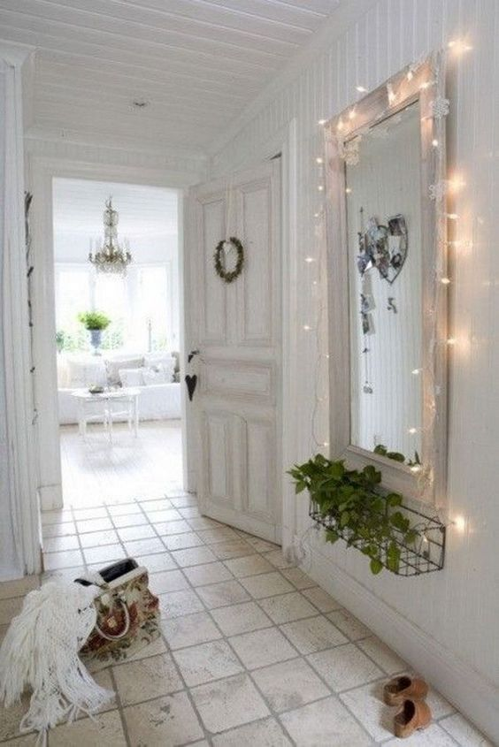 cover the mirror with string lights to accent it and make the space more amazing