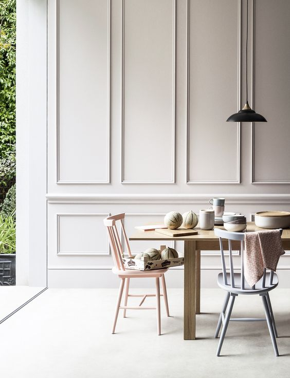 this dining space is made more refined with molding on the walls