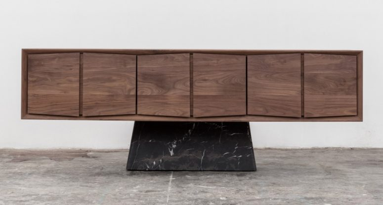 The Trinchador credenza features wooden cabinets with a 3D effect and a black marble bse