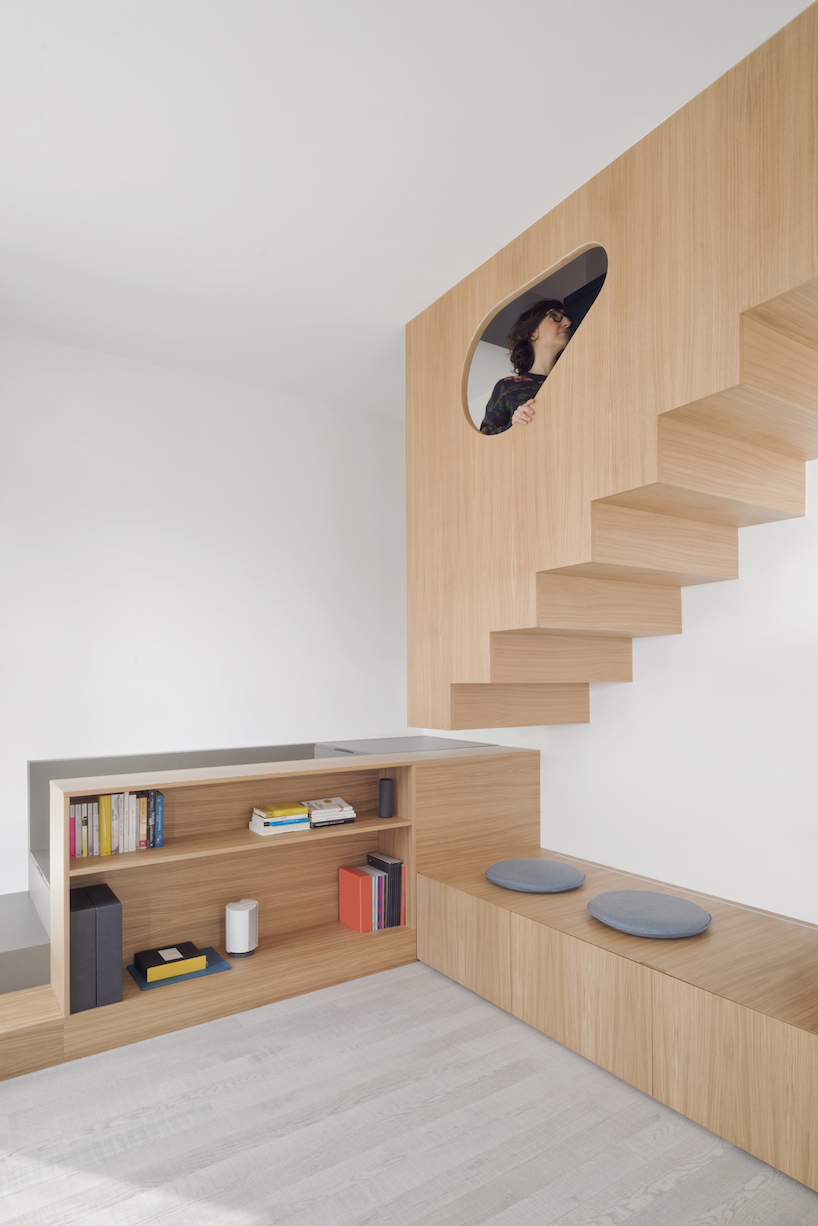 The staircase was cut and a part of it was changed for a large wooden block