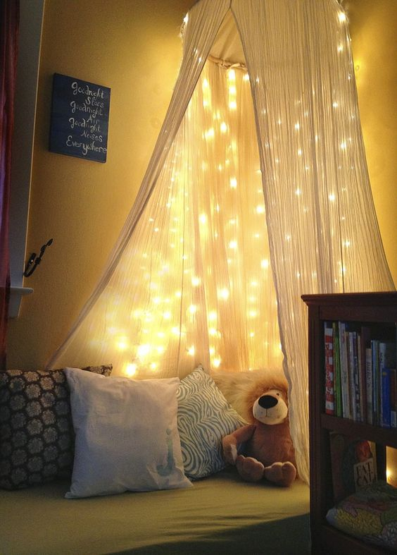 a bed canopy with lots of string lights works as a night light if necessary