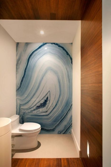 bold blue agate wallpaper can be used to accentuate a boring wall in your bathroom