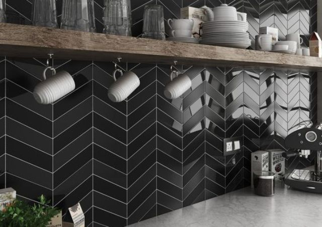 elegant matte and glossy black chevron tiles with white grout look wow