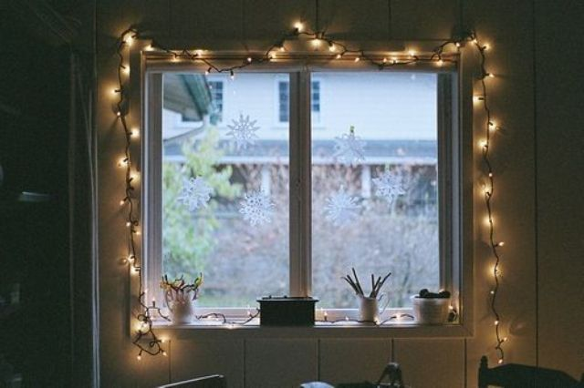 highlighting the window with string lights is a cute and chic idea to add more light inside