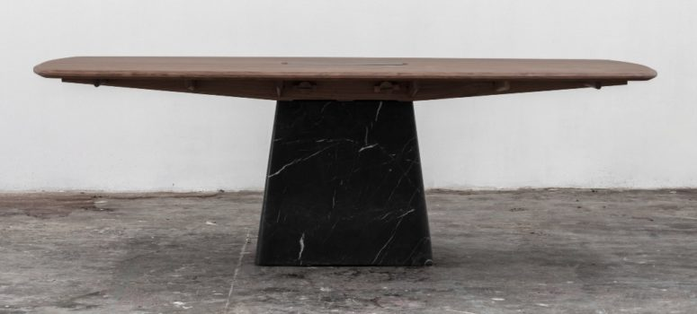 The Dolmen dining table is placed on a black marble base, too and has interesting edges