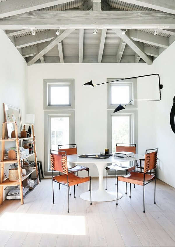 The home office or designer's studio is done with industrial touches - just look at those metal and leather chairs