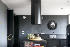 04 The kitchen is done with a lot of black – black walls, tiles, appliances, cabinets