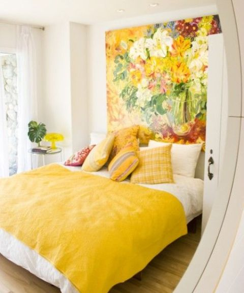 a whole headboard wall taken by a bold flower artwork in spring shades