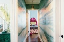 04 make a long and boring corridor bold and chic with green agate wallpaper and brass touches