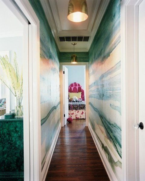 make a long and boring corridor bold and chic with green agate wallpaper and brass touches