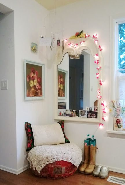 a feminine entryway decor with a mirror covered with string lights and pink touches for a girlish feel here