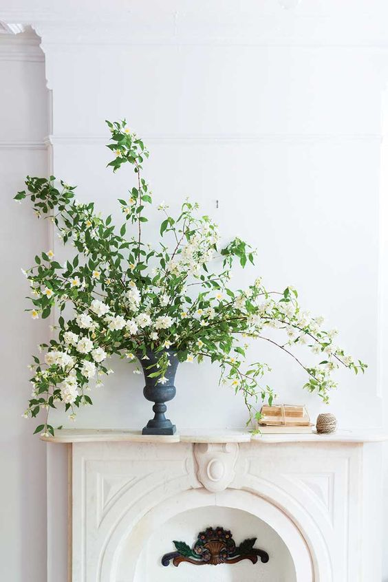 billowing branches of mock orange in an iron urn for beautiful and refined decor