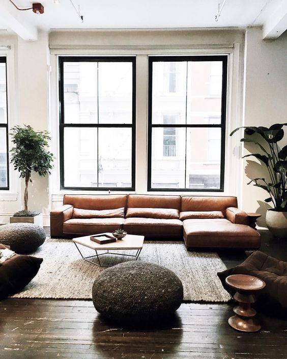 blank walls and double height windows make the living room amazing and filled with light