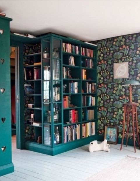 colorful bookshelves with glass inserts match the interior and accent the books with their bold color