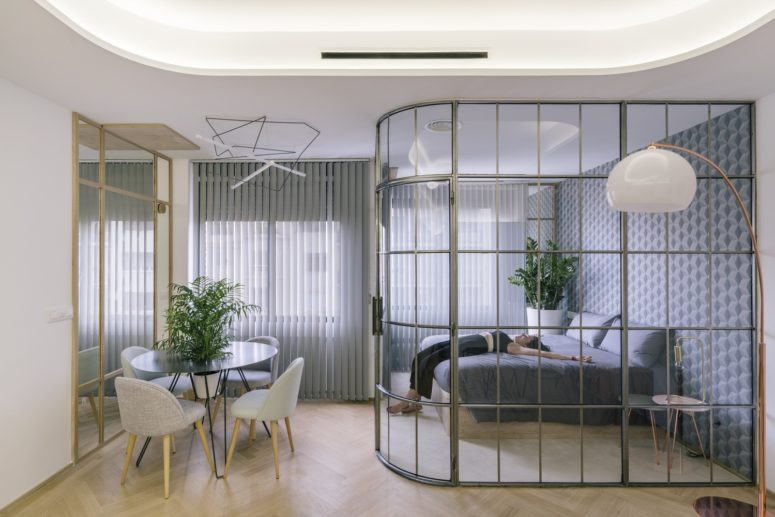 open up your apartment using glass walls, so there won't be bulky dividers
