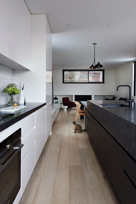 The color palette is rather light, and there are some black accents to make the interiors more interesting