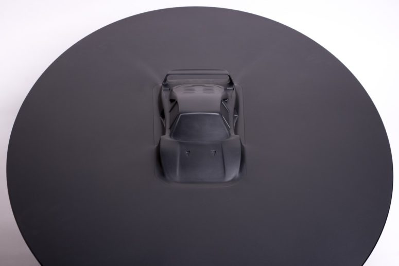 01-Bold-Ford-GT-table-features-a-vehicle-that-seems-to-be-appearing-from-liquid-metal-in-the-center-of-the-table-775x590 Jaw-Dropping Vehicle Table To Catch Everybody's Eyes