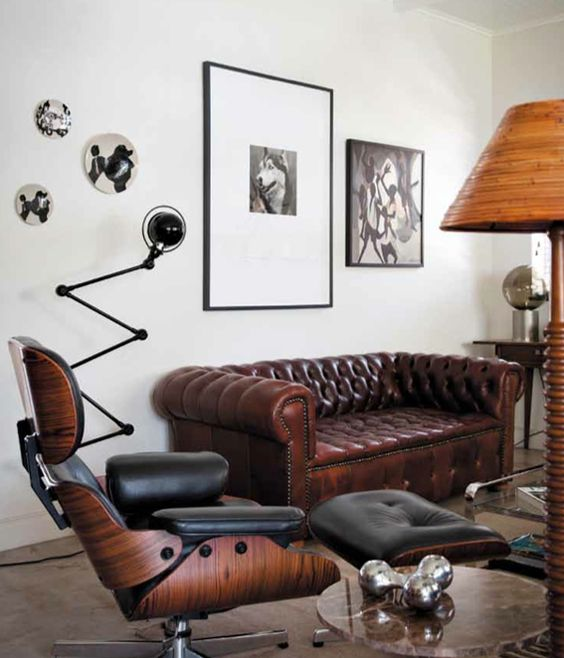 a masculine space with a brown leather sofa that defines the whole space