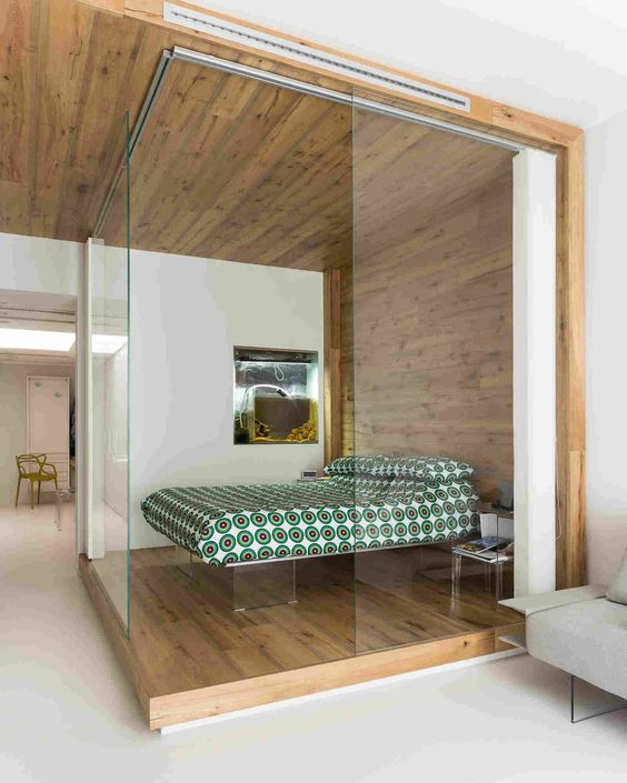 a small glass covered bedroom with acrylic furniture for a contemporary feel