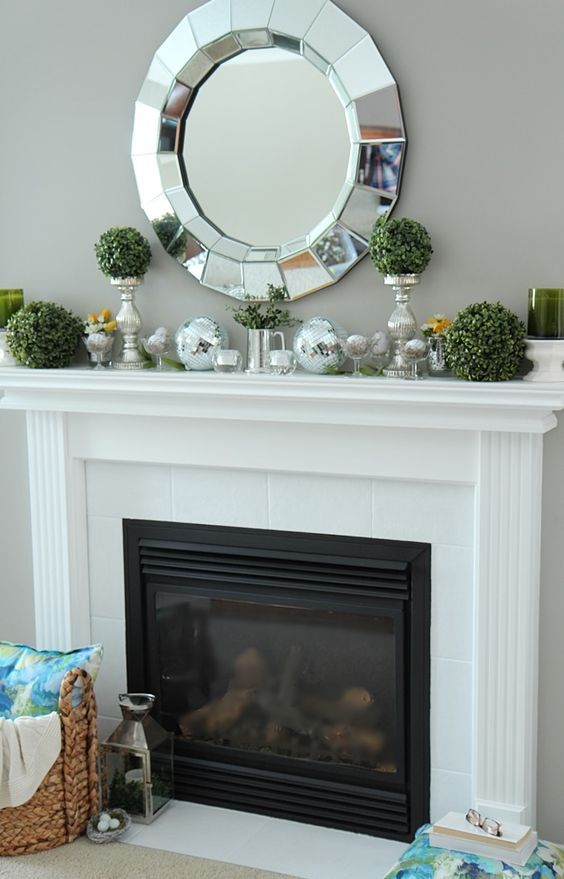 boxwood balls and eggs in glasses are all you need for a stylish spring mantel