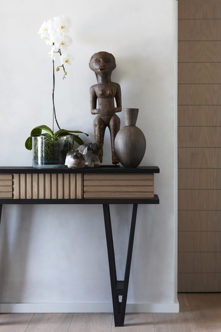 Most of furniture, like this console table, was custom-made to show off a modern take on traditional African culture