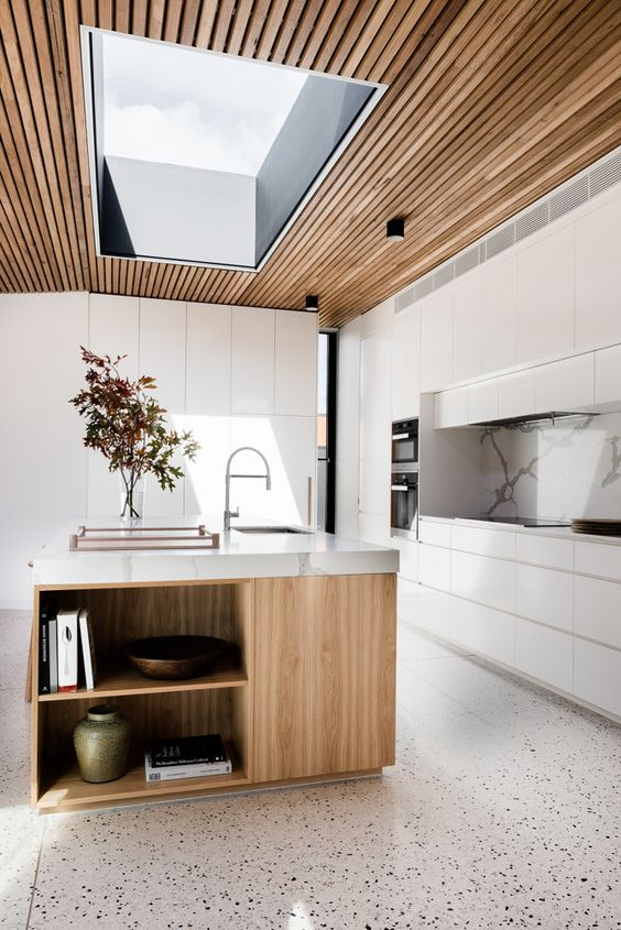 a ceiling clad with wooden slabs and with a large skylight is a very fresh option