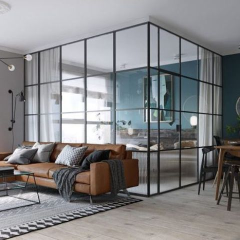 a framed glass bedroom to divide it from the dining and living spaces plus curtains for more privacy