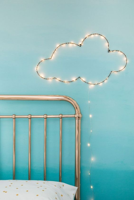 a little cloud of string lights over the bed will make any sleeping space cuter and will add light here