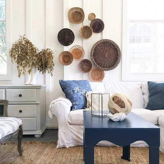 a seaside space spruced up with a basket collection on the wall