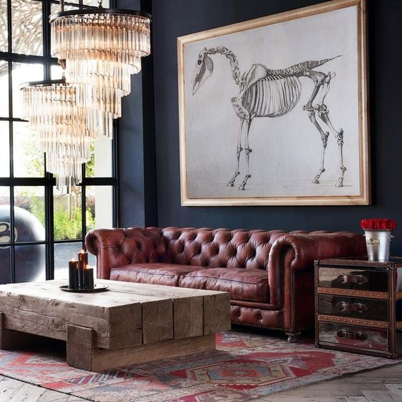 An Eclectic Space With A Rough Wooden Beam Table, Glam Crystal Chandeliers  And A Brown