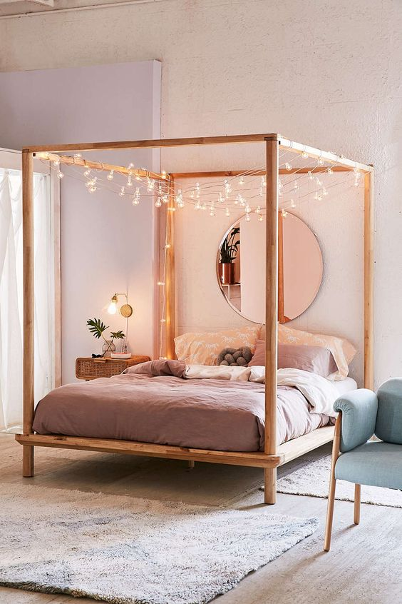 hang string lights on the bed frame to make falling asleep cuter