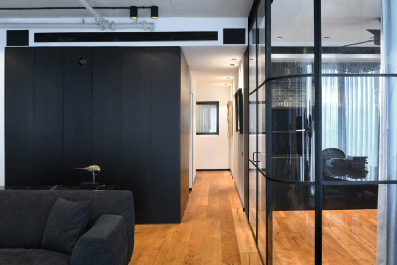 The bedroom cube is clad with dark wood on the outside