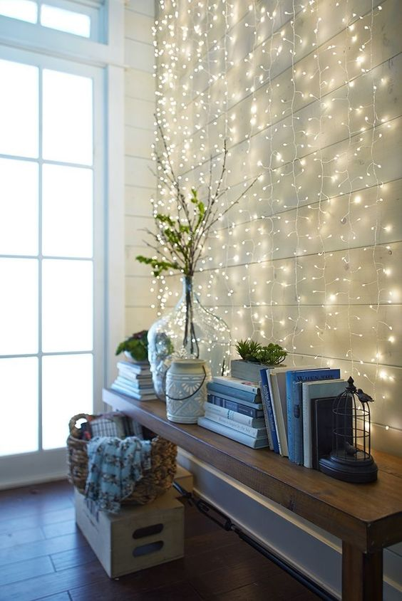 a whole wall with string lights hanging makes the entryway magical and cute
