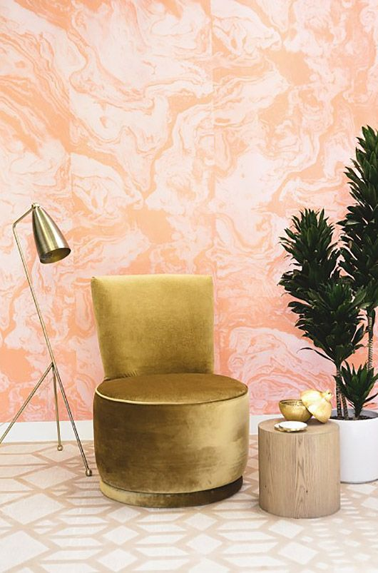 pink agate wallpaper and brass items make this nook very glam