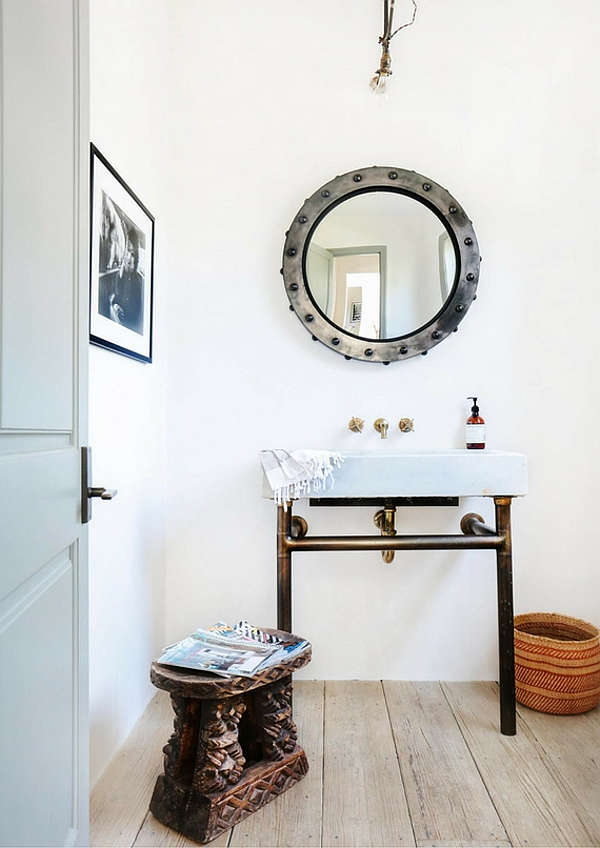 A guest bathroom features chic industrial touches - avanity and a mirror were custom-made