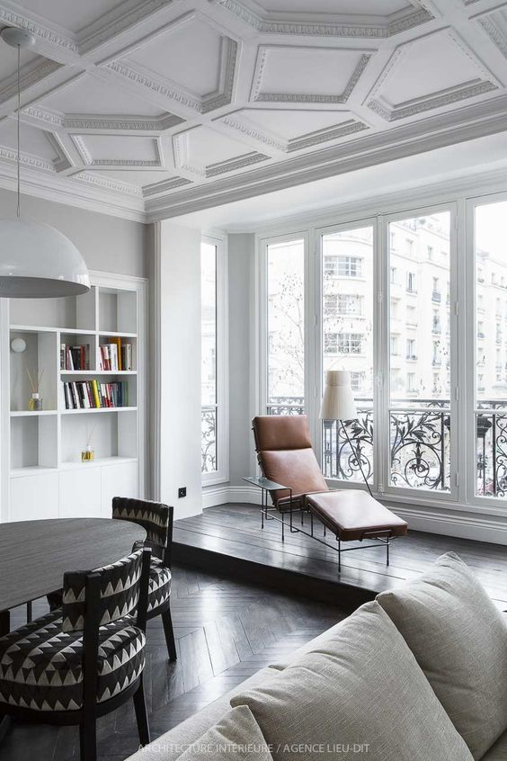 chic white molded ceiling adds a refined feel to the space and turns the whole space into an elegant one