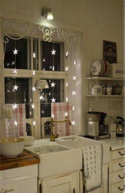 cute star string lights as window decor are great not only for winter holidays but all year round