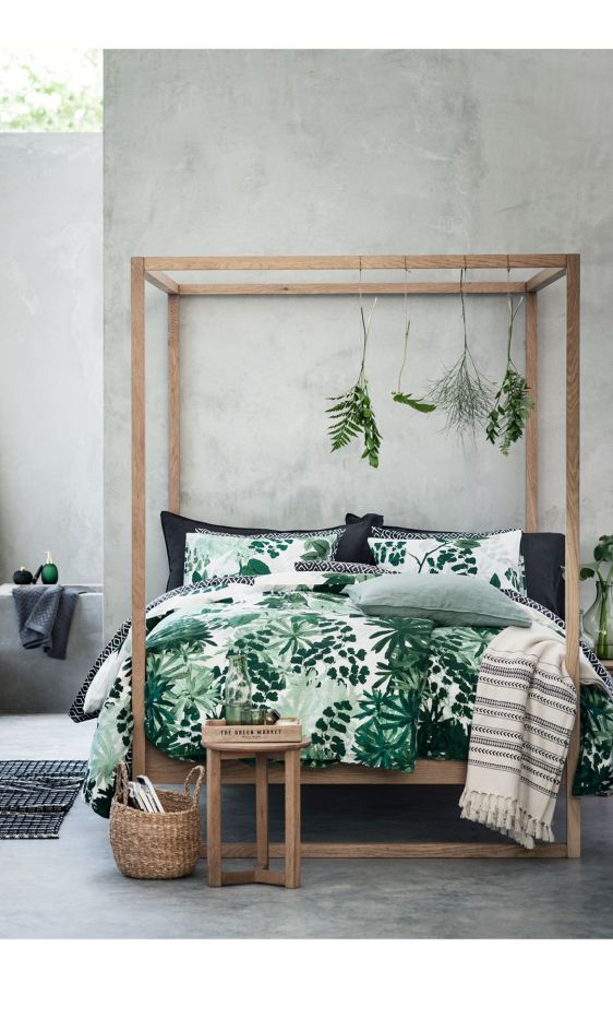 greenery bedding set and some herbs hanging on the bed frame for a fresh spring look