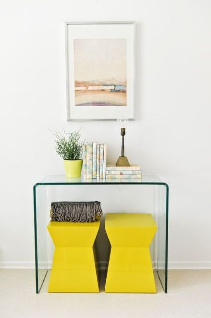 lemon yellow stools and a matching planter with greenery for minimalist spring decor