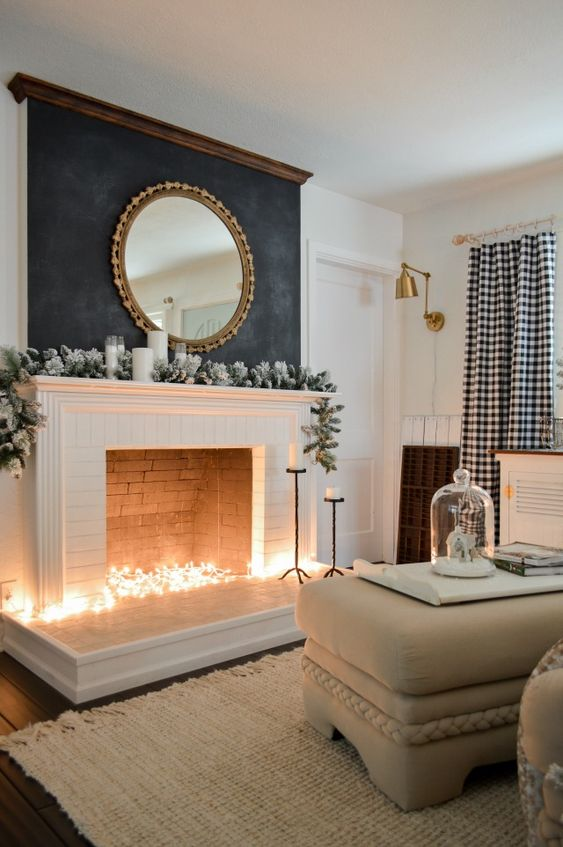 put some string lights into the fireplace to imitate light   it will instantly add coziness