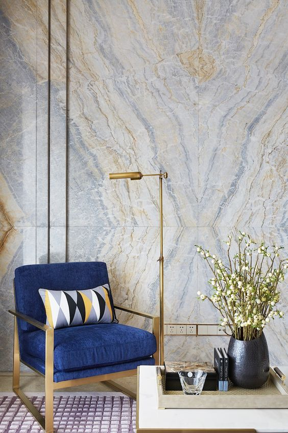 delicate blue and gold geode wallpaper perfectly matches the furniture and lamp